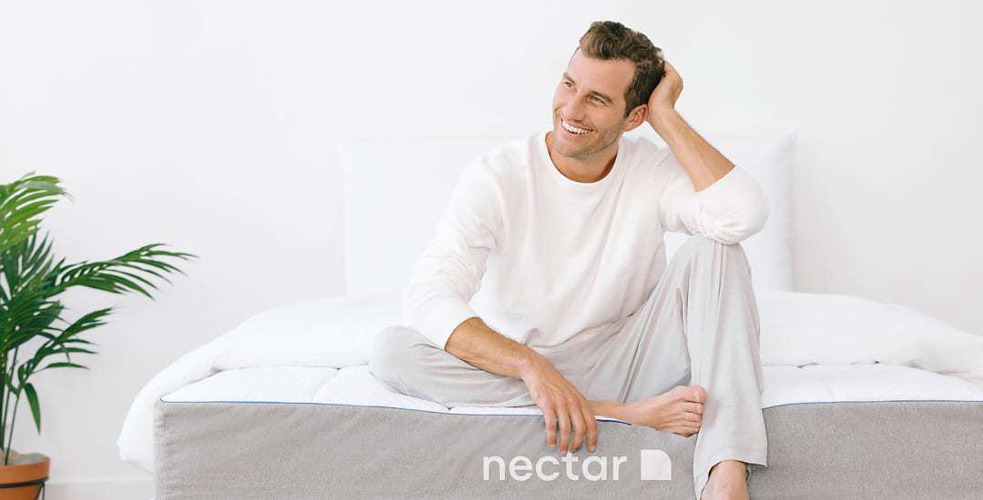 Man Sitting on Nectar Bed