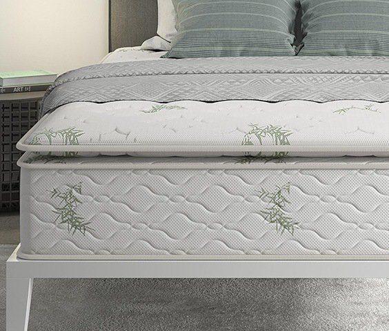 Pillow top mattress placed on a bed frame