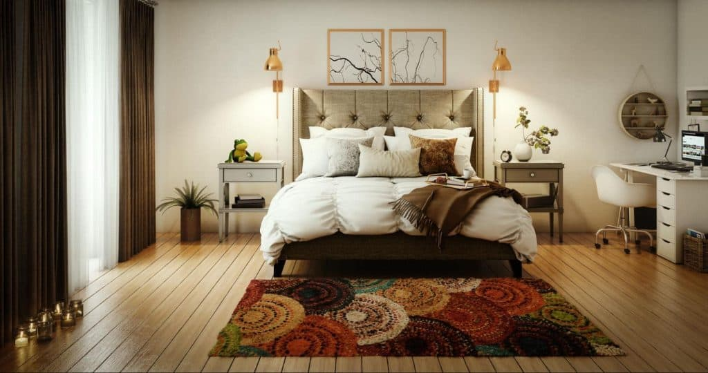 A Comforter and pillows on a bed in master bedroom with a beautiful interior