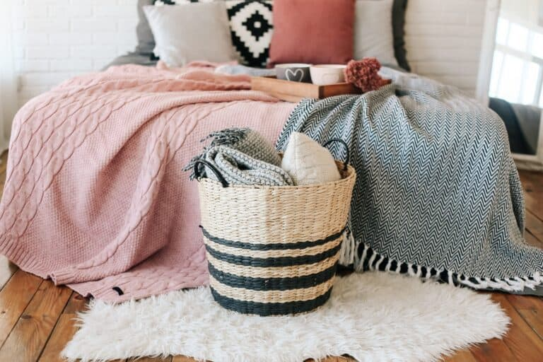 Different types of blankets on a bed