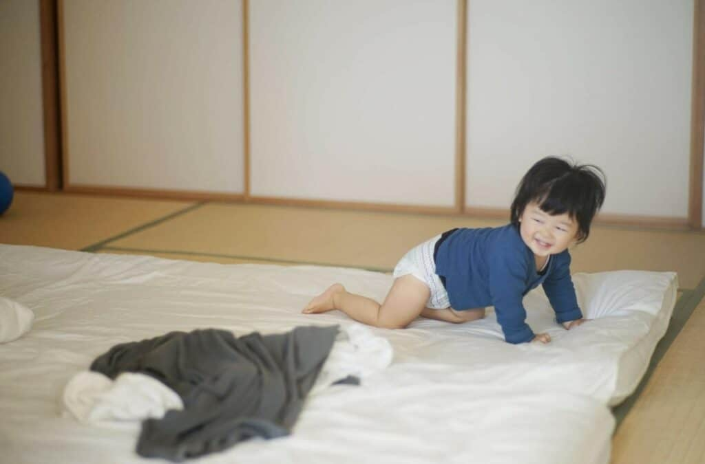 A Baby Playing on the Floor