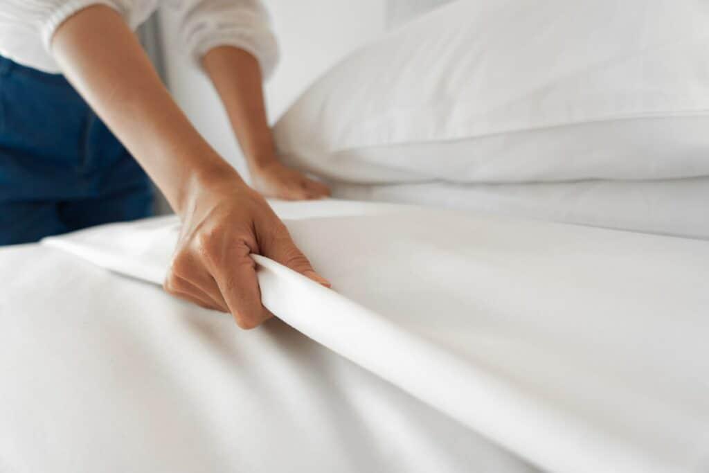 Female Hand set up white bedsheet
