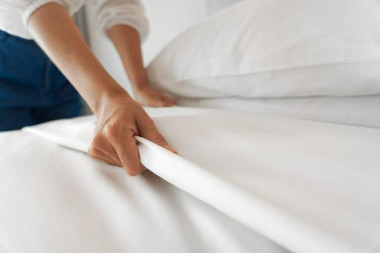 Female Hand set up white bed sheet