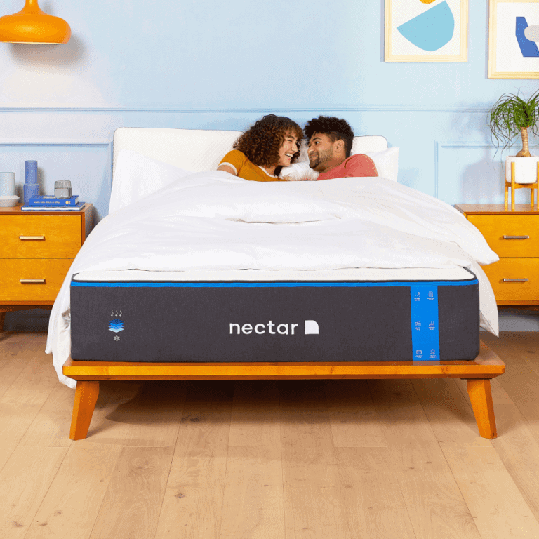 """Young couple on full size bed. (standard full size mattress size is 54"""" x 75"""")"""