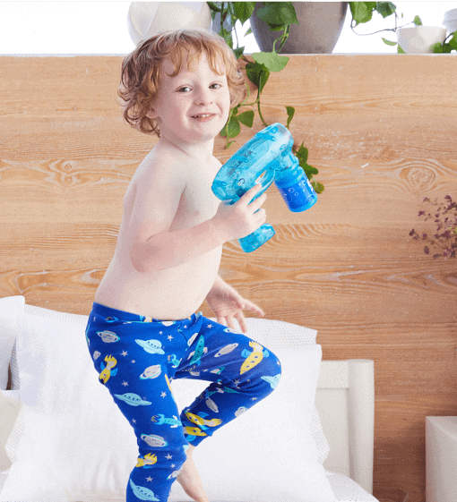 young kid playing on bed