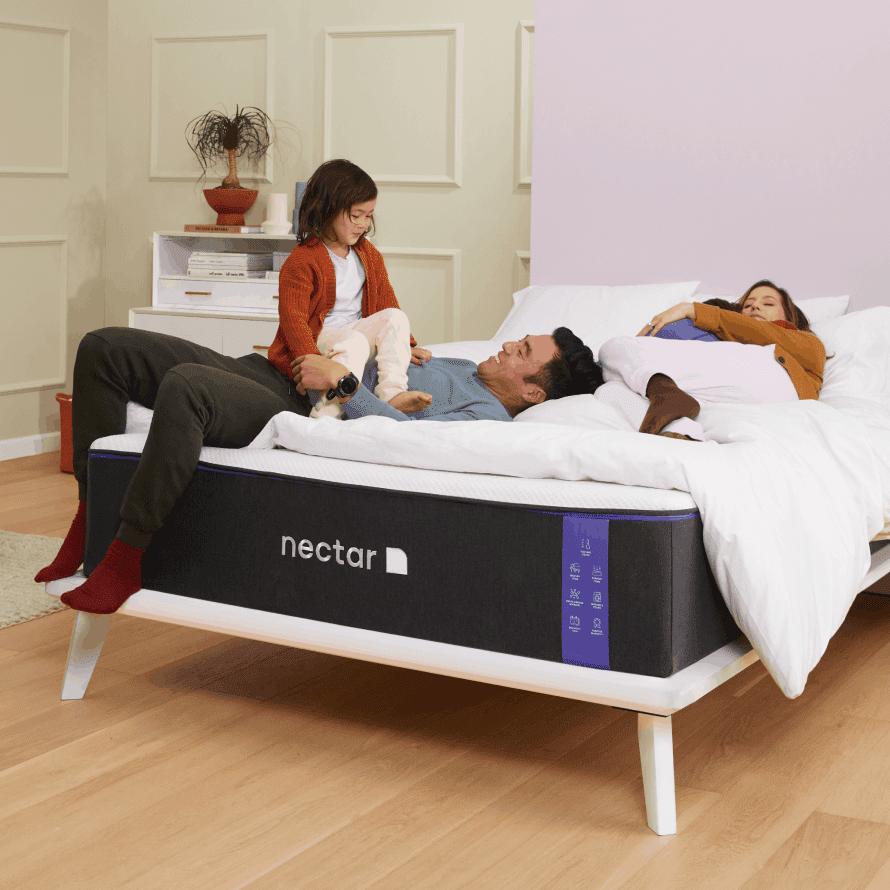 "Family on a Nectar King Mattress measuring 76"" x 80"" (standard king mattress size)"