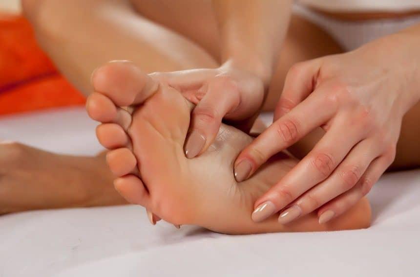 A Young Woman Massaging Her Feet