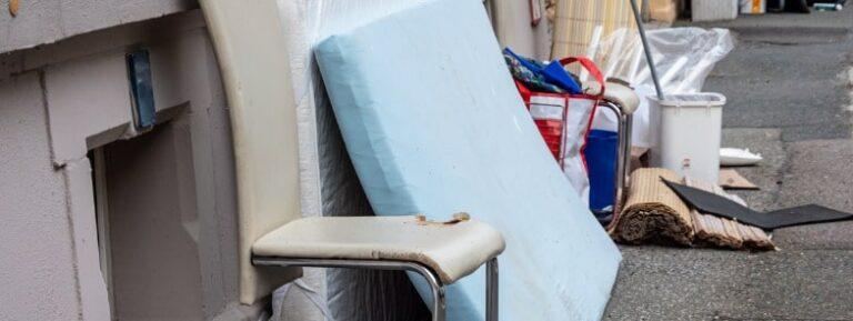 A Mattress beside the wall outside the mattress disposal center