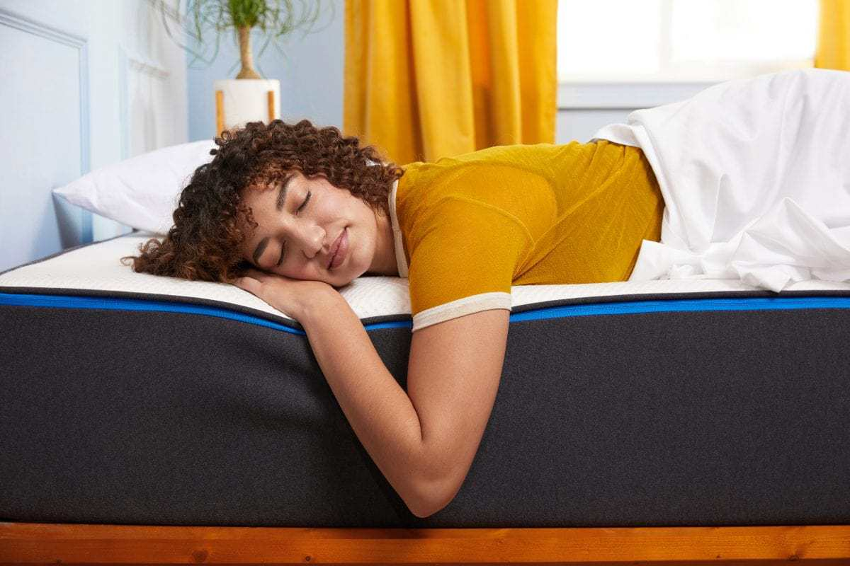 A girl sleeping on a Nectar mattress