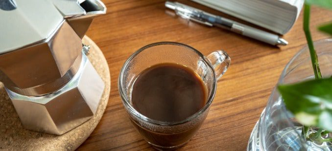 A Cup of Coffee on a Working Table