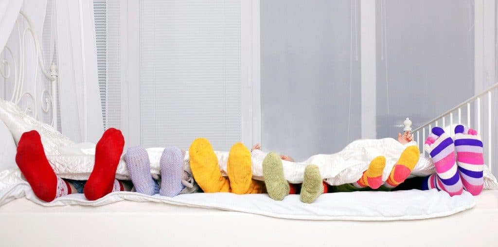 A Family sleeping on a oversized mattress