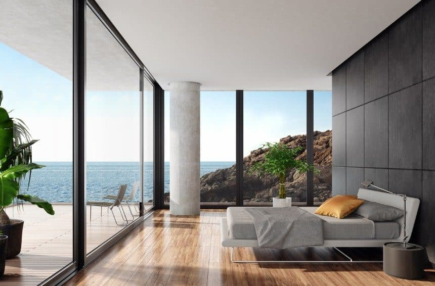 modern luxurious bedroom with oversized mattress in it with sea side view