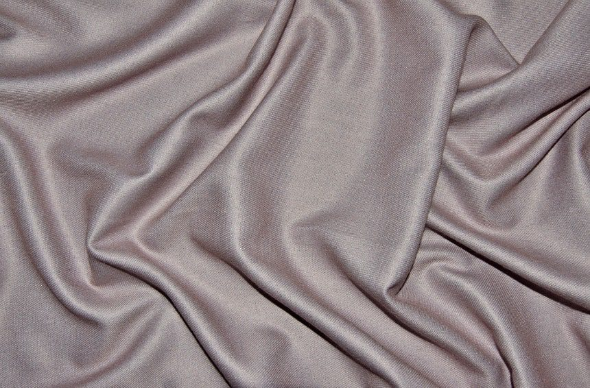 Top View of Pale Pink Woolen With Viscose Fabric With Soft Folds