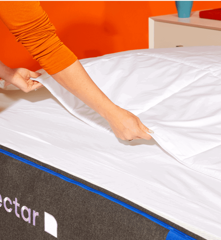 A woman hand set up bed sheet after washing it