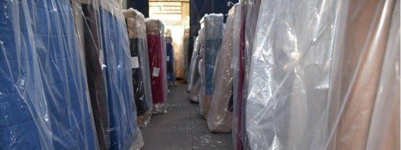 Many mattresses stored in a mattress storage unit